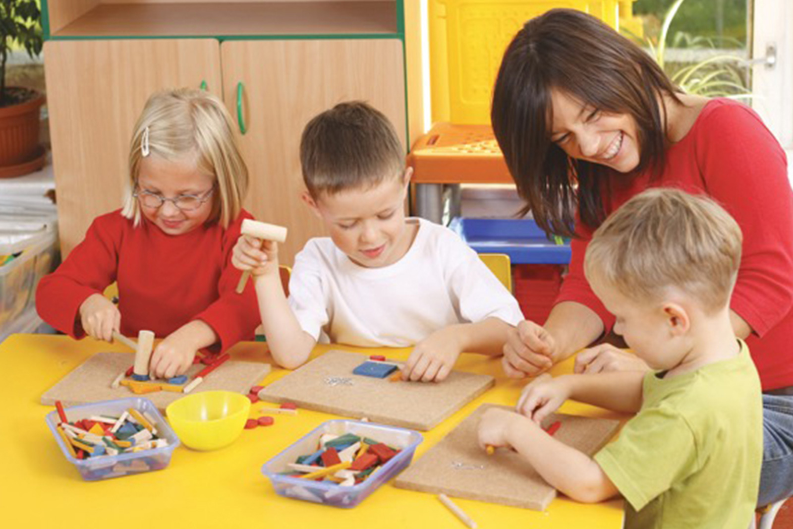 Children and caregiver at play at daycare